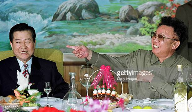 South Korean President Kim Daejung left and North Korean leader Kim Jong Il share a laugh at a luncheon June 15 2000 held in Pyongyang North Korea...