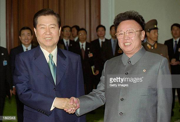 South Korean President Kim Daejung left shakes hands with North Korean leader Kim Jong Il as they meet for talks June 14 2000 on the second day of a...