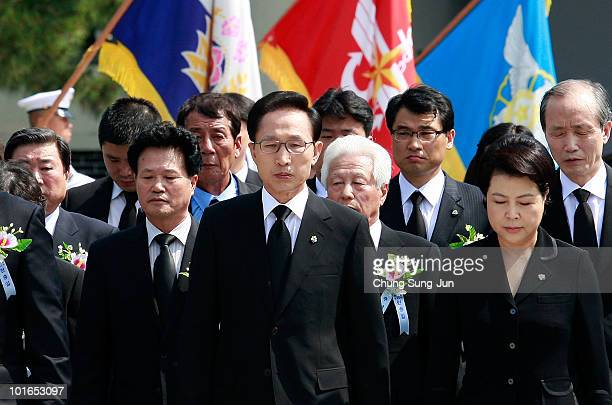 South Korean President Lee MyungBak and his wife Kim YoonOk arrive for burning incense during a ceremony marking Korean Memorial Day at the Seoul...