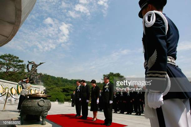 South Korean President Lee MyungBak and his wife Kim YoonOk bow during a ceremony marking Korean Memorial Day at the Seoul National Cemetery on June...