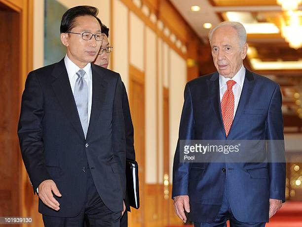 South Korean President Lee MyungBak and Israeli President Shimon Peres walk before their meeting at the presidential blue house on June 10 2010 in...