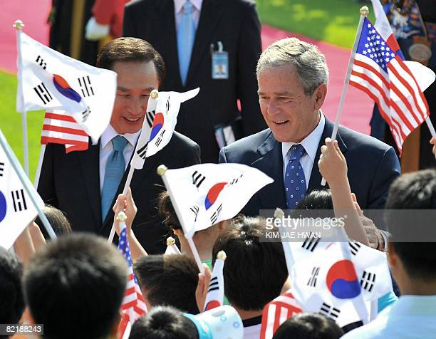 South Korean President Lee MyungBak and US President George W Bush take part in a welcome ceremony in the Grand Garden of the presidential Blue House...