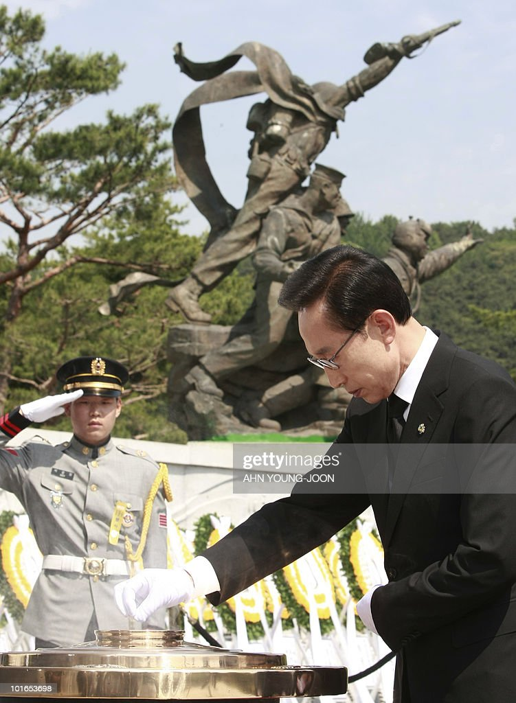South Korean President Lee Myung-bak burns incense as he pays his respects during a ceremony for Memorial Day at the national cemetery in Seoul on June 6, 2010. The United States and its Asian allies demanded North Korea pay a price for the alleged sinking of a South Korean warship, even as Washington acknowledged diplomacy may have no effect on the reclusive regime.