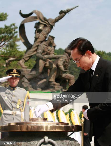 South Korean President Lee MyungBak burns incense during a ceremony marking Korean Memorial Day at the Seoul National Cemetery on June 6 2010 in...