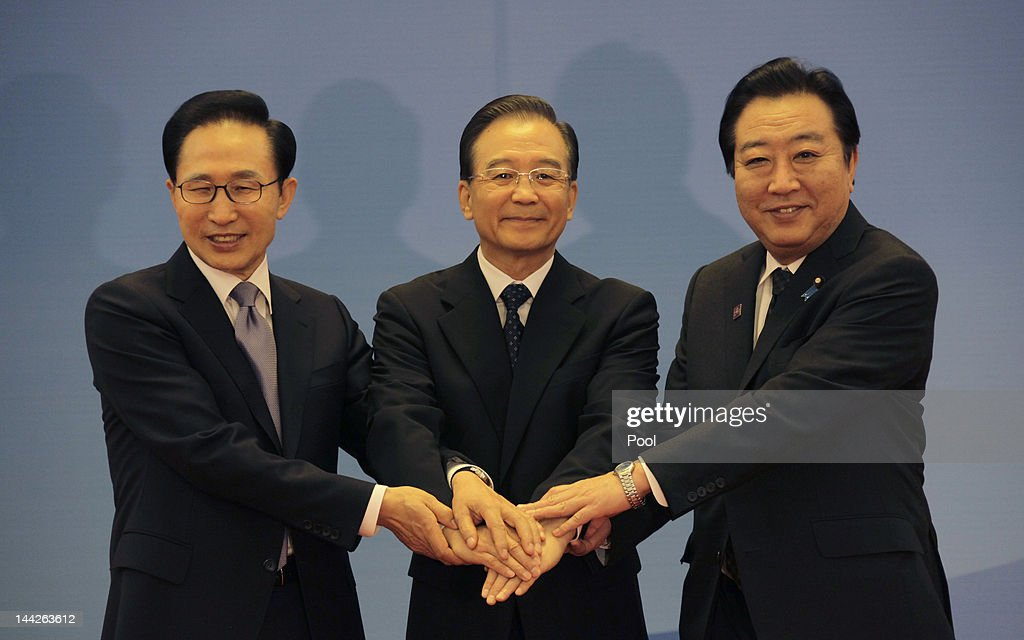 South Korean President Lee Myung-bak, China Premier Wen Jiabao and Japanese Prime Minister Yoshihiko Noda pose for photographs at the Great Hall of the People May 13, 2012 in Beijing, China. The three are meeting for talks focused on maintaining strong relations, the global economy and disaster relief. The trilateral summits began in 2008.