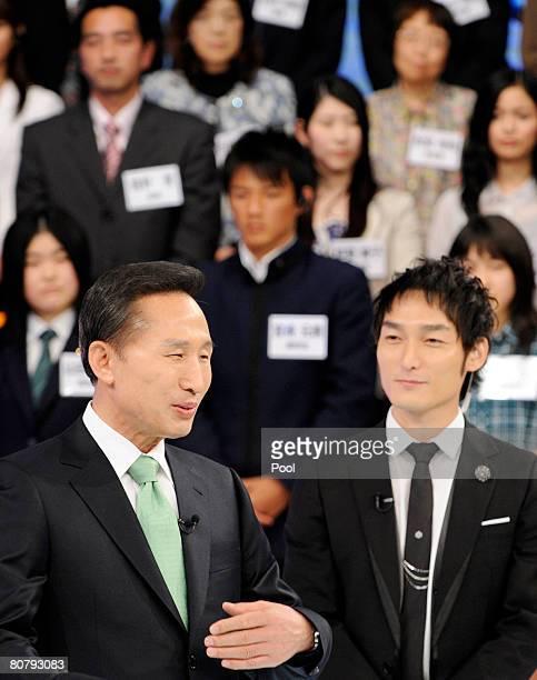 South Korean President Lee MyungBak delivers a speech as Japanese singer Tsuyoshi Kusanagi known as Chonan Gang in South Korea looks on during a TV...