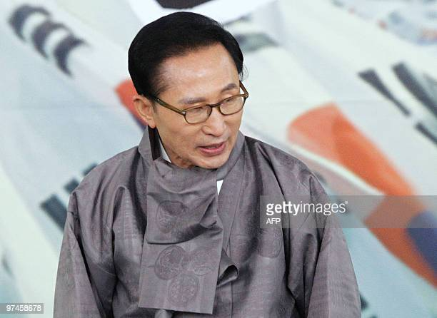 South Korean President Lee Myung-Bak greets people after his remembrance ceremony speech marking the 91st anniversary of the March First Independence...