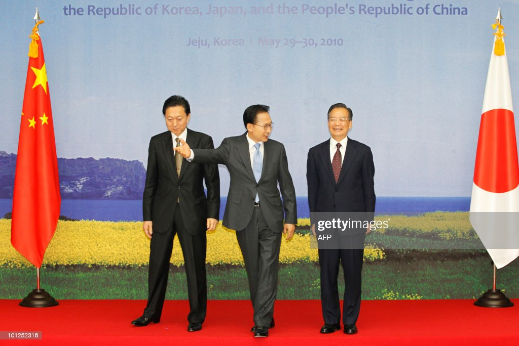 South Korean President Lee Myung-bak (C) leads Japanese Prime Minister Yukio Hatoyama (L) and Chinese Premier Wen Jiabao after posing for a group photo before their summit in Seogwipo on Jeju island, south of Seoul on May 29, 2010. China came under intensified pressure from South Korea and Japan on Saturday to join global efforts to punish North Korea over the sinking of a South Korean warship in March.