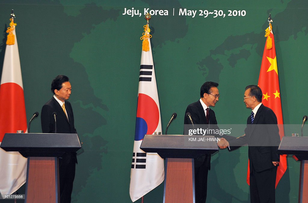 South Korean President Lee Myung-Bak (C) shakes hands with Chinese Premier Wen Jiabao (R) as Japanese Prime Minister Yukio Hatoyama (L) looks at the end of a joint press conference following trilateral summit meetings in Seogwipo on Jeju island, south of Seoul, on May 30, 2010. China's Premier Wen Jiabao said there is an 'urgent' need to avoid clashes and ease tensions following the sinking of a South Korean warship. But Wen, speaking after a summit with the Japanese and South Korean leaders, gave no indication that China is ready to join them in blaming North Korea for the incident.
