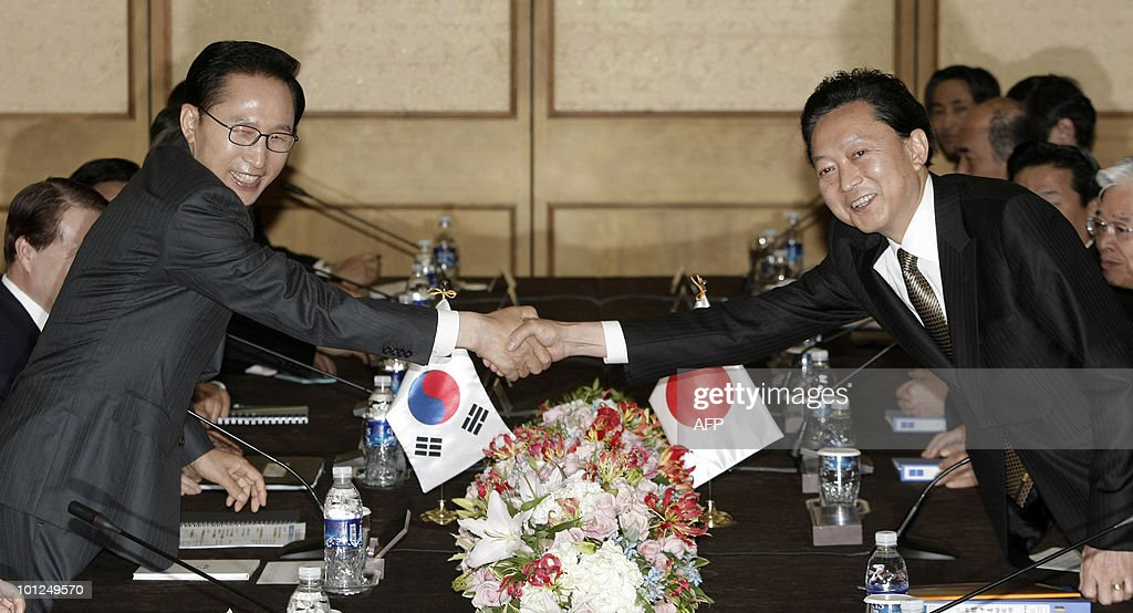 South Korean President Lee Myung-Bak (L) shakes hands with Japanese Prime Minister Yukio Hatoyama during their meeting to discuss the situation with North Korea in Seogwipo City on Jeju Island on May 29, 2010.