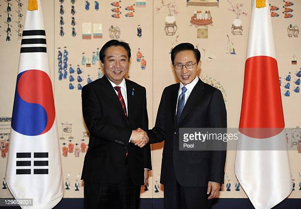 South Korean President Lee MyungBak shakes hands with Japanese Prime Minister Yoshihiko Noda during their meeting at the Presidential House on...