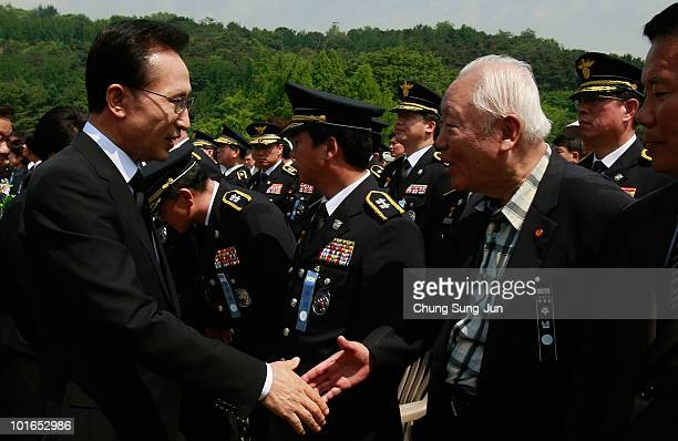 South Korean President Lee MyungBak shakes hands with parcitipant during a ceremony marking Korean Memorial Day at the National Cemetery on June 6...