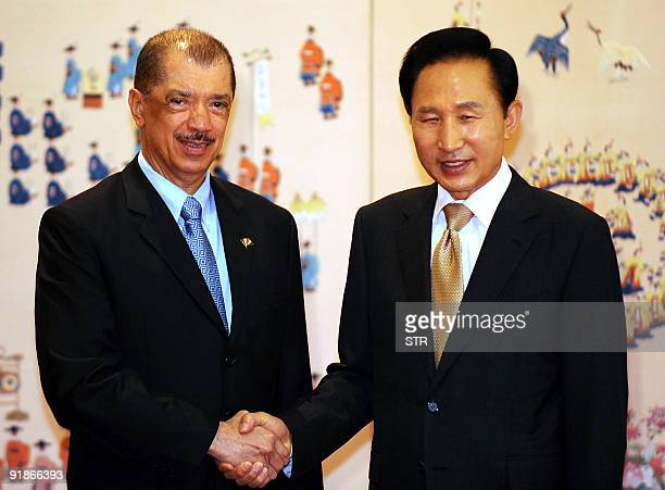 South Korean President Lee MyungBak shakes hands with Seychelles President James Alix Michel before their meeting at the presidential Blue House in...