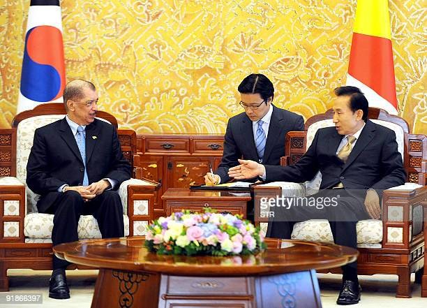 South Korean President Lee MyungBak talks with Seychelles President James Alix Michel during their meeting at the presidential Blue House in Seoul on...