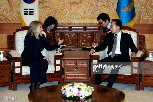 South Korean President Lee MyungBak talks with US Secretary of State Hillary Clinton during their meeting at the Presidential House on April 17 2011...