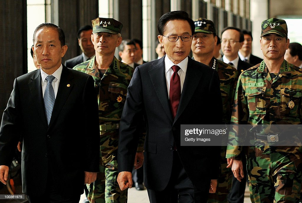 South Korean President Lee Myung-Bak (R) walks with defense minister Kim Tae-Young for the press conference at the War Memorial on May 24, 2010 in Seoul, South Korea. President Lee announced to take the North to UN Security Council.