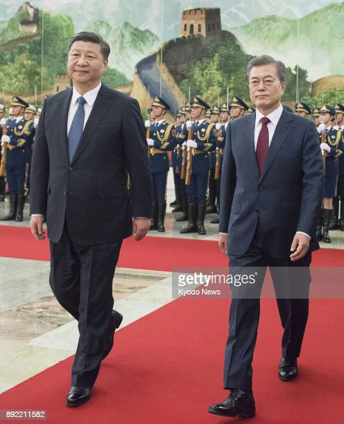 South Korean President Moon Jae In and his Chinese counterpart Xi Jinping attend a ceremony to welcome the former held at the Great Hall of the...