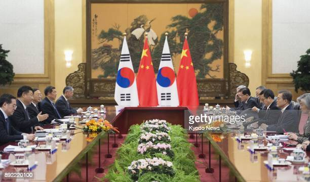 South Korean President Moon Jae In and his Chinese counterpart Xi Jinping hold a summit meeting at the Great Hall of the People in Beijing on Dec 14...