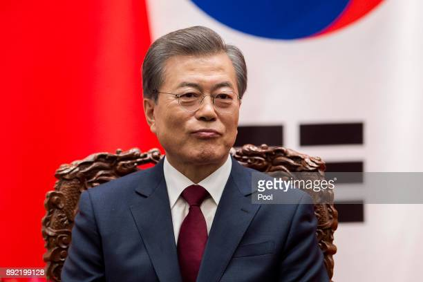 South Korean President Moon JaeIn and Chinese President Xi Jinping attend a signing ceremony at the Great Hall of the People on December 14 2017 in...