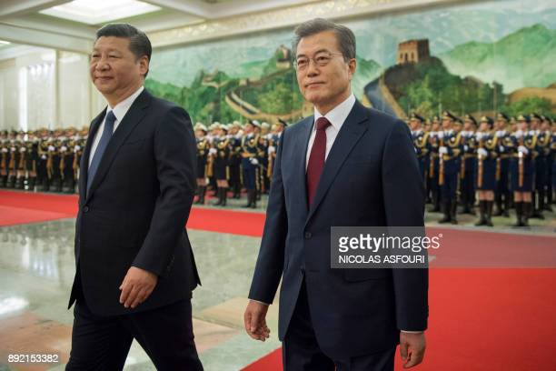 South Korean President Moon JaeIn and Chinese President Xi Jinping review the Chinese honour guard during a welcome ceremony at the Great Hall of the...