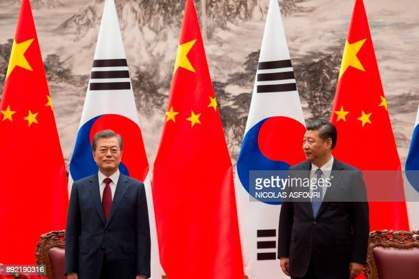 South Korean President Moon JaeIn and Chinese President Xi Jinping are seen during a signing ceremony at the Great Hall of the People in Beijing on...