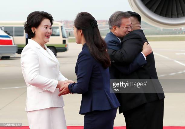 South Korean President Moon Jaein and his wife Kim Jungsook are welcomed by North Korean leader Kim Jong Un and his wife Ri Sol Ju upon their arrival...