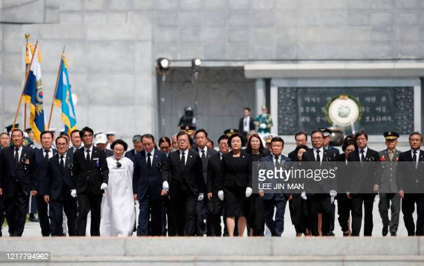 South Korean President Moon Jaein and his wife Kim Jungsook attend a Memorial Day ceremony at the national cemetery in Daejeon on June 6 2020