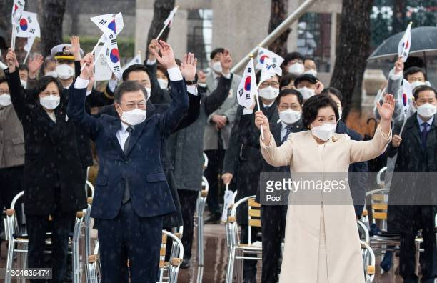 South Korean president Moon Jae-in and his wife Kim Jung-sook , give three cheers during a ceremony of the 102nd Independence Movement Day ceremony...