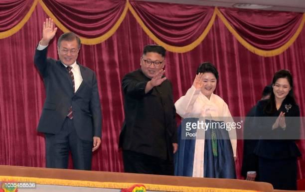 South Korean President Moon Jaein and his wife Kim Jungsook North Korean leader Kim Jong Un and his wife Ri Sol Ju attend the art performance at...