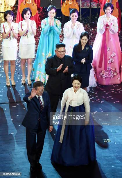 South Korean President Moon Jaein and his wife Kim Jungsook wave to the audience as North Korean leader Kim Jong Un and his wife Ri Sol Ju look on...
