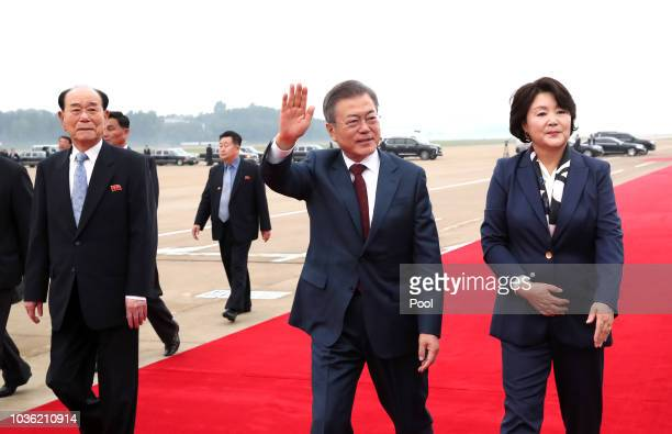 South Korean President Moon Jae-in and his wife Kim Jung-sook wave to North Koreans as they leave for Mount Paektu, at Pyongyang Sunan International...