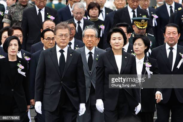 South Korean President Moon Jae-in and his wife Kim Jung-suk attend a ceremony marking Korean Memorial Day at the Seoul National cemetery on June 6,...