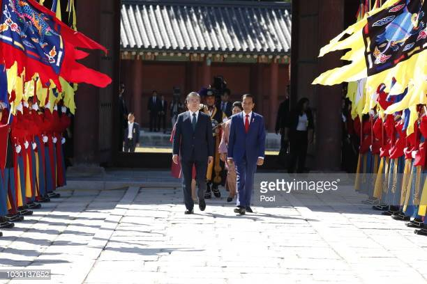 South Korean President Moon Jae-In and Indonesian President Joko Widodo inspect an honor guard during a welcoming ceremony at the Changdeokgung...