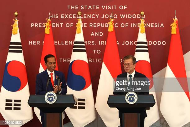 South Korean President Moon Jae-In and Indonesian President Joko Widodo attend the press conference at the Presidential blue house on September 10,...