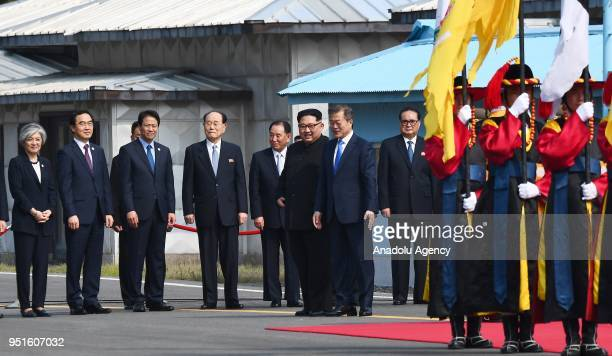 South Korean President Moon Jaein and North Korean leader Kim Jongun are seen during welcoming ceremony within a meeting at the southern side of the...
