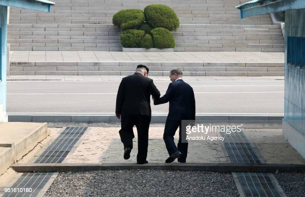 South Korean President Moon Jaein and North Korean leader Kim Jongun are seen during a meeting at the southern side of the truce village of Panmunjom...