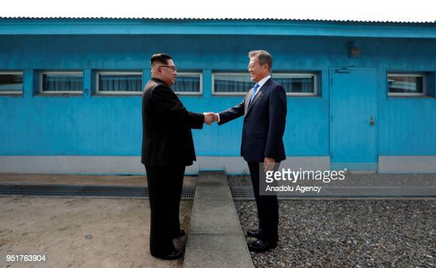 South Korean President Moon Jaein and North Korean leader Kim Jongun meet at the Military Demarcation Line of the truce village of Panmunjom South...