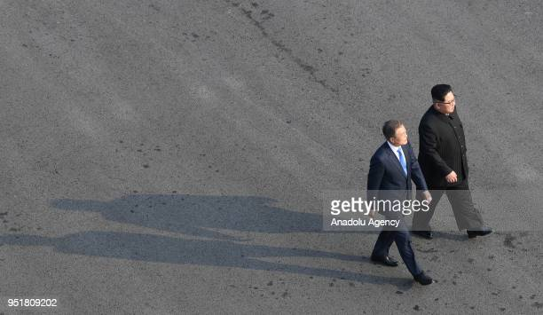 South Korean president, Moon Jae-in and North Korean leader Kim Jong-un take a walk after planting a commemorative tree in the Peace House building...