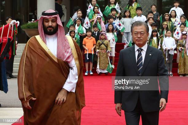 South Korean President Moon Jae-In and Saudi Crown Prince Mohammed bin Salman walk towards a guard of honour during a welcoming ceremony at the...