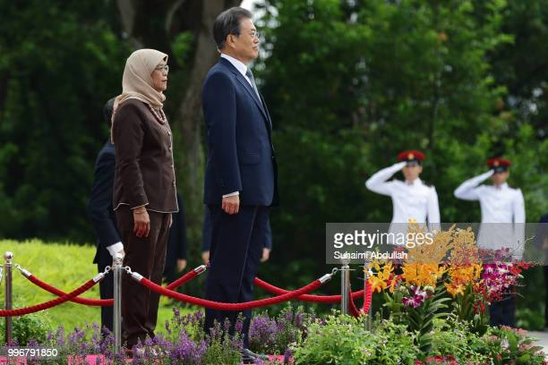 South Korean President Moon Jaein and Singapore President Halimah Yacob attend the welcome ceremony at the Istana on July 12 2018 in Singapore Moon...