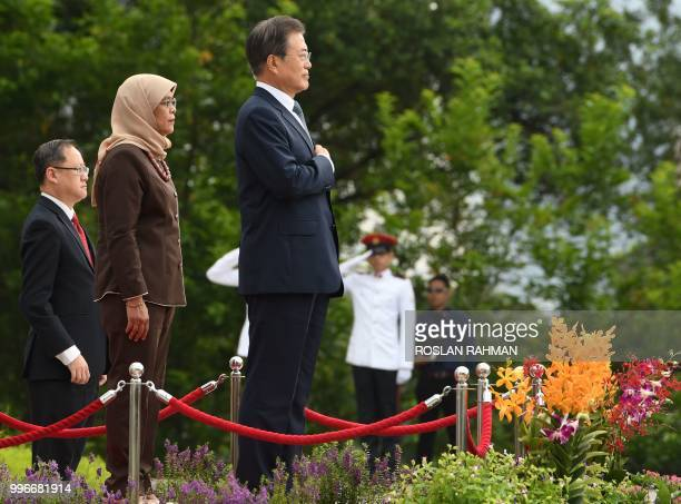South Korean President Moon Jaein and Singaporean counterpart Halimah Yacob attend a welcoming ceremony ceremony at Istana presidential in Singapore...