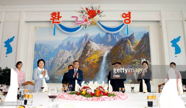 South Korean President Moon Jaein attends with his wife his wife Kim Jungsook North Korean leader Kim Jong Un and his wife Ri Sol Ju during a lunch...