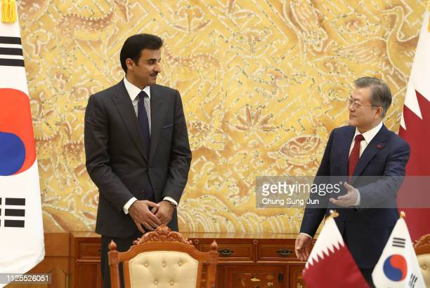 South Korean President Moon Jae-in attends with Qatar's Emir Sheikh Tamim bin Hamad Al Thani during a signing agreement following their meeting at...