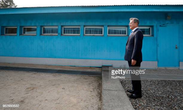 South Korean President Moon Jaein awaits North Korean Leader Kim Jong Un's arrival at the military demarcation line prior to the InterKorean Summit...