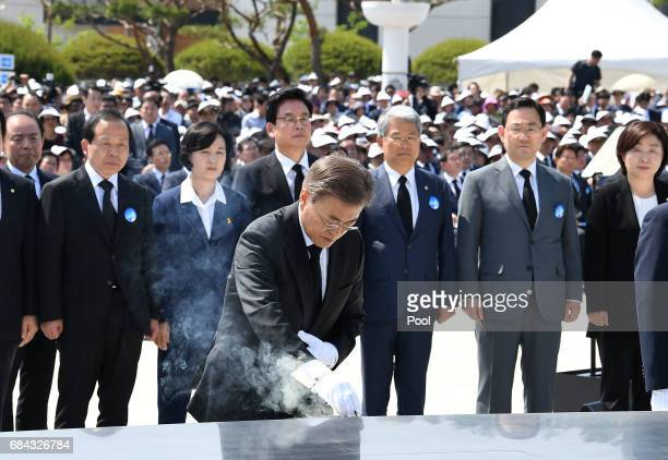 South Korean President Moon Jaein burns incense during the 37th annual May 18 Democratic Uprising memorial at the Gwangju National Cemetery on May 18...