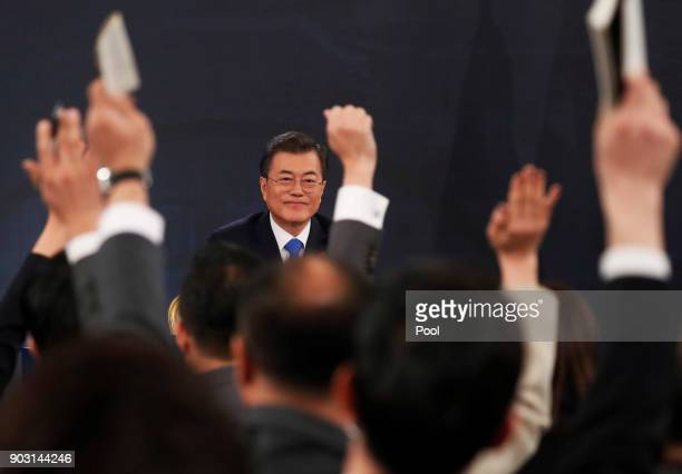 South Korean President Moon Jaein delivers a speech during his New Year news conference at the Presidential Blue House on January 10 2018 in Seoul...