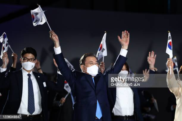 South Korean President Moon Jae-in gives three cheers during the celebration of 75th anniversary of the Liberation Day at Dongdaemun Design Plaza in...