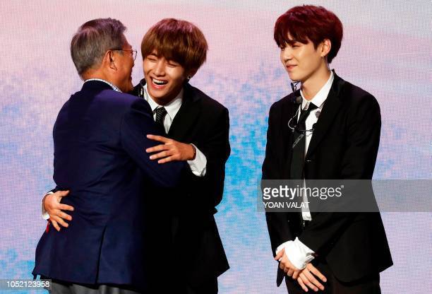 South Korean President Moon Jaein greets the members of South Korean pop group BTS during a Korean cultural event as part of South Korean President...