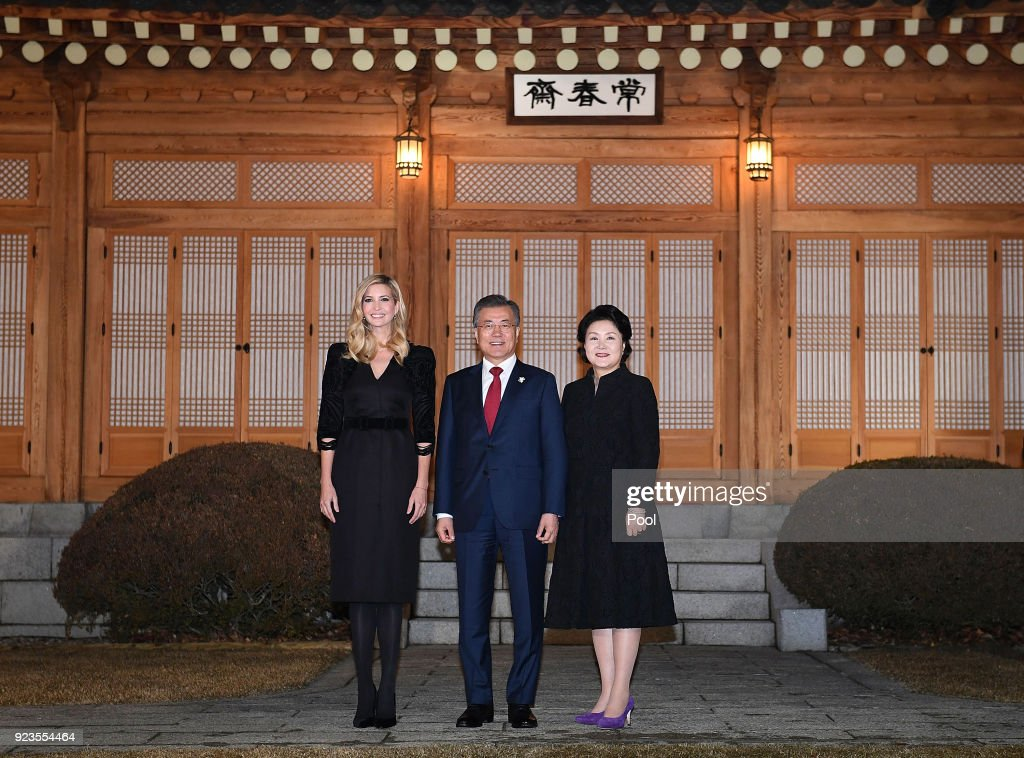 South Korean President Moon Jae-In (C), his wife Kim Jung-Sook (R) and Ivanka Trump (L) pose for photograph during their dinner at the Presidential Blue House on February 23, 2018 in Seoul, South Korea. Ivanka Trump is on a four-day visit to South Korea to attend the closing ceremony of the Pyeongchang Winter Olympics and to meet South Korean President Moon.