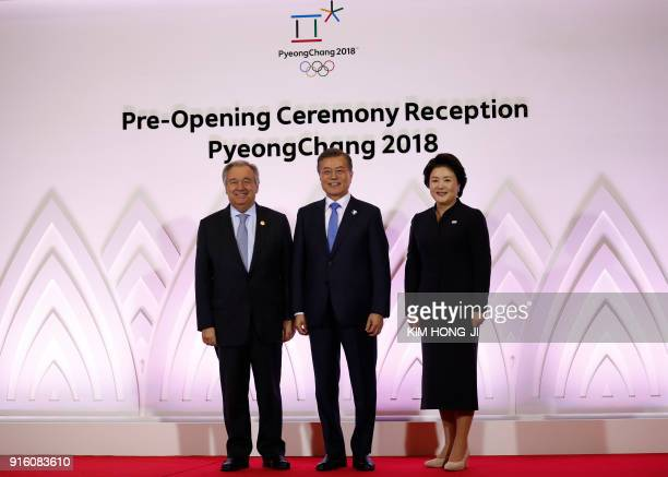 South Korean President Moon Jaein his wife Kim JungSuk and UN Secretary General Antonio Guterres pose for photographs during the Olympic Opening...